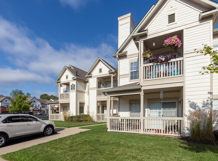 This is a photo of apartment exteriors showing private patios and balconies at The Sanctuary at Fishers in Fishers, IN.