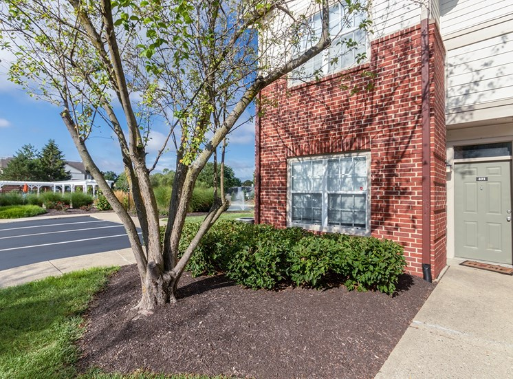 This is a photo of apartment exteriors showing a private entrance at The Sanctuary at Fishers in Fishers, IN.