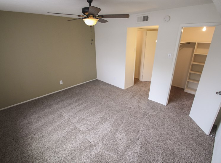 This is a photo of the bedroom of the 751 square foot 1 bedroom apartment at Woodbridge Apartments in Dallas, TX.