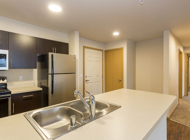 Fully Equipped Kitchen with Microwave, Refrigerator, Dishwasher and USB Outlet