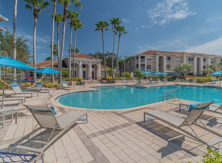 Poolside Relaxing Area at The Boot Ranch Apartments, Florida, 34685