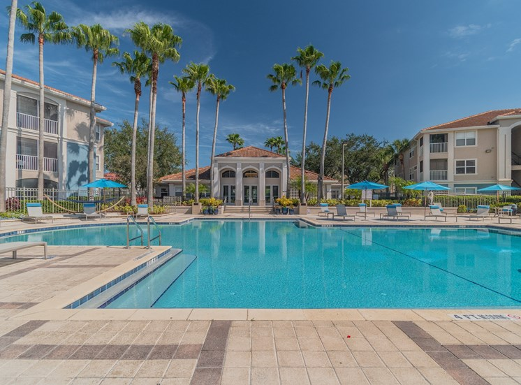 Swimming Pool with Lounge Seating at The Boot Ranch Apartments, Palm Harbor