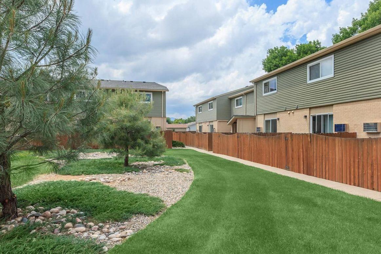 Alder Square property exterior grounds with patio fences
