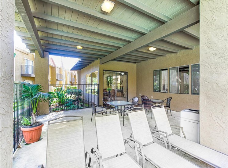 Outdoor community patio at Woodlake Apartments in Escondido, CA, For Rent. Now leasing Studio, 1 and 2 bedroom apartments.