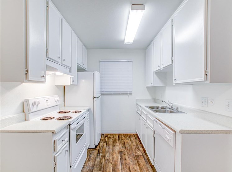 Dishwasher and disposal at Woodlake Apartments in Escondido, CA, For Rent. Now leasing Studio, 1 and 2 bedroom apartments.
