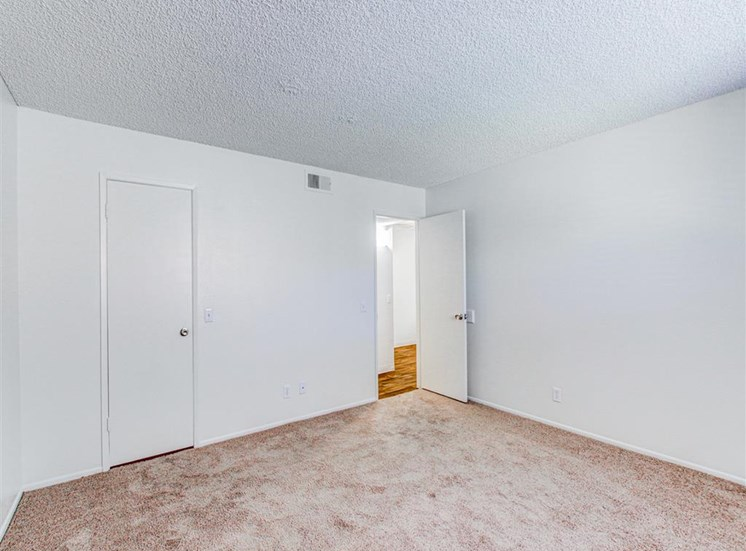 Spacious bedroom at Woodlake Apartments in Escondido, CA, For Rent. Now leasing Studio, 1 and 2 bedroom apartments.