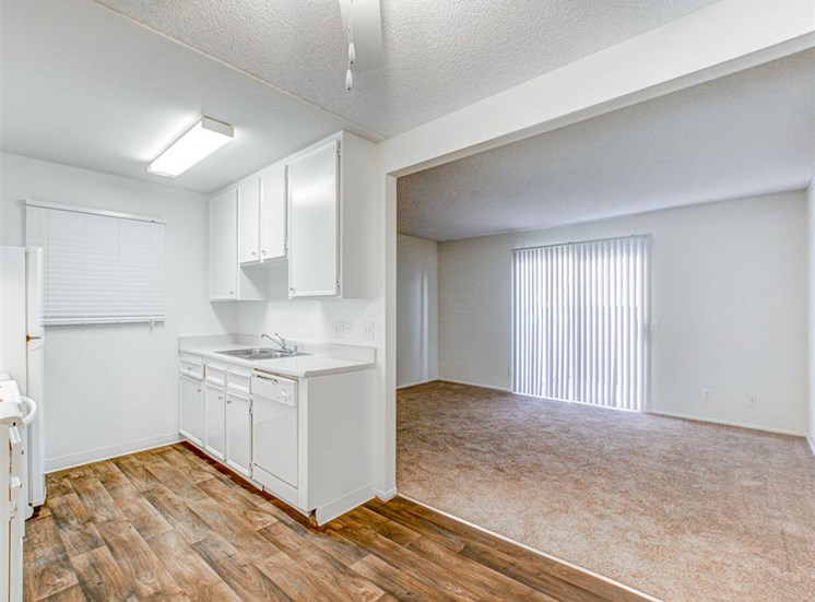 Kitchen open to entertaining area at Woodlake Apartments in Escondido, CA, For Rent. Now leasing Studio, 1 and 2 bedroom apartments.