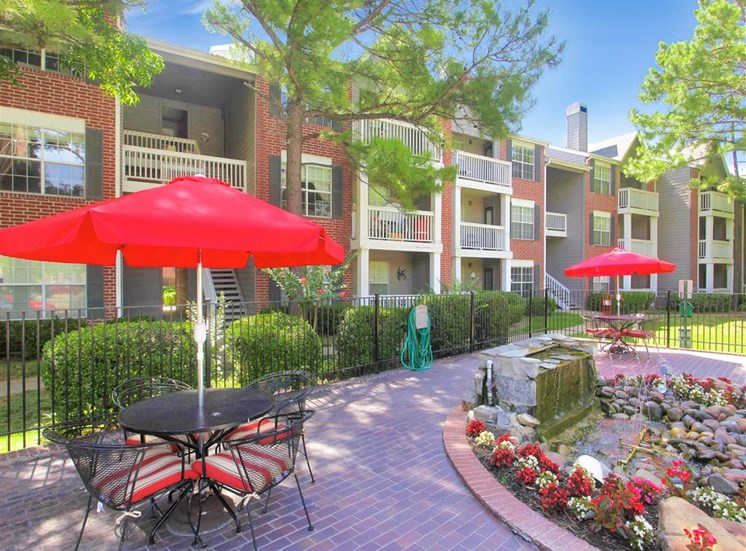 Fountains, outdoor seating areas, patios and balconies at Greenbriar in South Tulsa, OK, 1 and 2 bedroom apartments available.