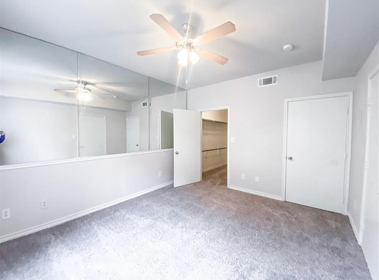 Spacious bedroom with walk in closet at Tuscany Square Apartments in North Dallas, TX, For Rent. Now leasing Studio, 1 and 2 bedroom apartments.