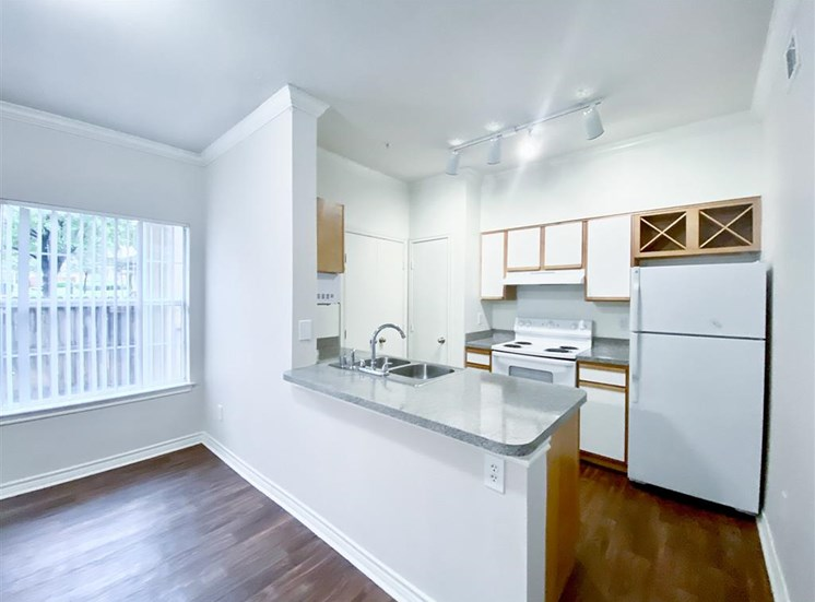Spacious kitchen at Tuscany Square Apartments in North Dallas, TX, For Rent. Now leasing Studio, 1 and 2 bedroom apartments.