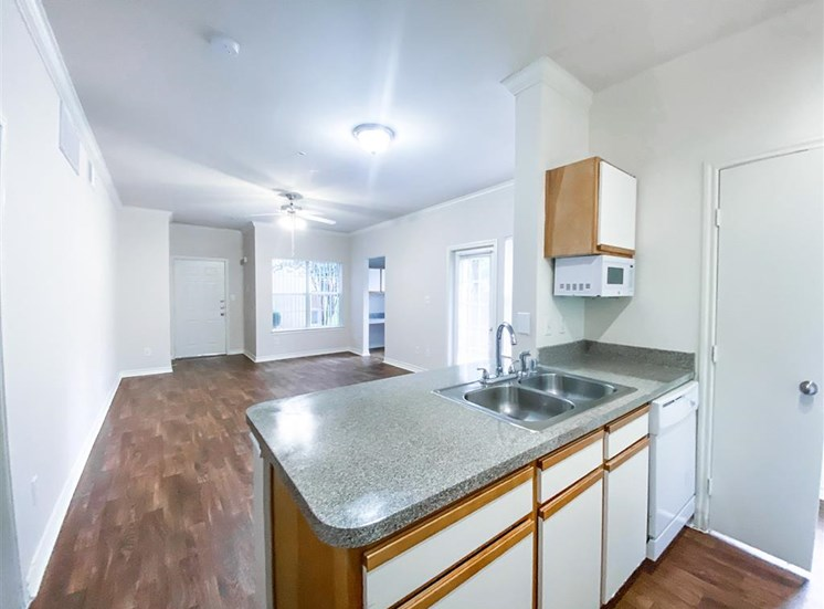 Microwave, dishwasher and private backyard at Tuscany Square Apartments in North Dallas, TX, For Rent. Now leasing Studio, 1 and 2 bedroom apartments.