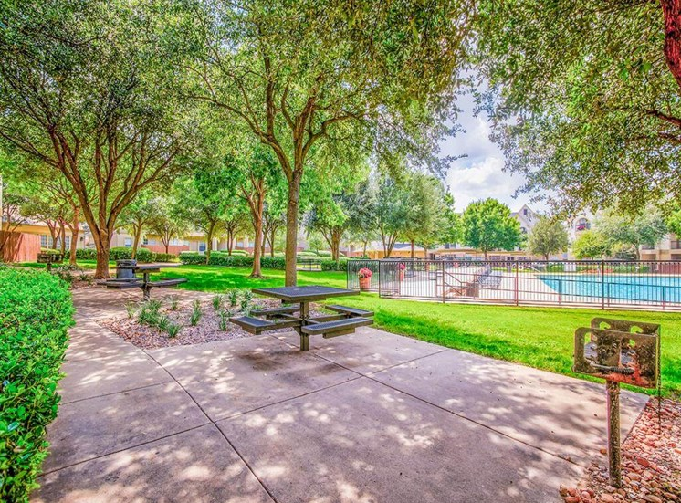 Lush courtyard with BBQ at Tuscany Square Apartments in North Dallas, TX, For Rent. Now leasing Studio, 1 and 2 bedroom apartments.