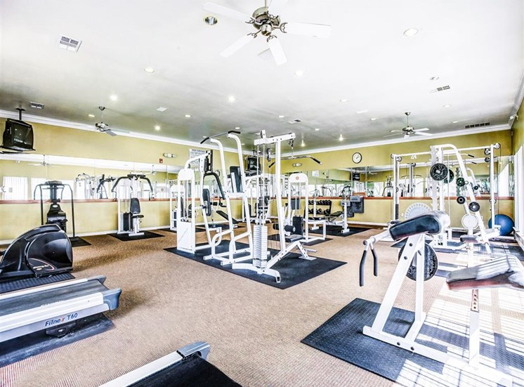 Gym, fitness center with cardio and weight machines at Tuscany Square Apartments in North Dallas, TX, For Rent. Now leasing Studio, 1 and 2 bedroom apartments.