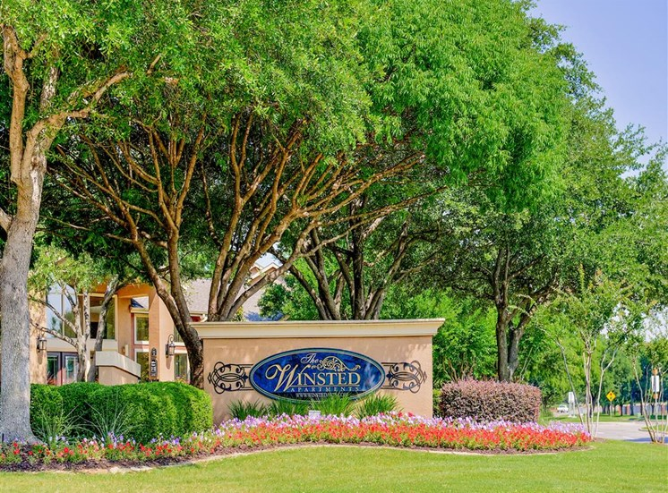 Mature trees at the entrance to The Winsted at Valley Ranch in Irving, TX, For Rent. Now leasing 1 and 2 bedroom apartments.