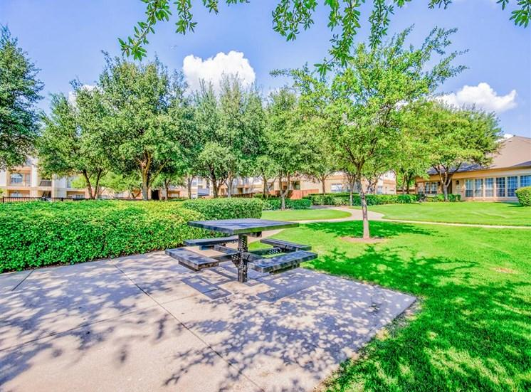 Huge courtyard with BBQs at Tuscany Square Apartments in North Dallas, TX, For Rent. Now leasing Studio, 1 and 2 bedroom apartments.