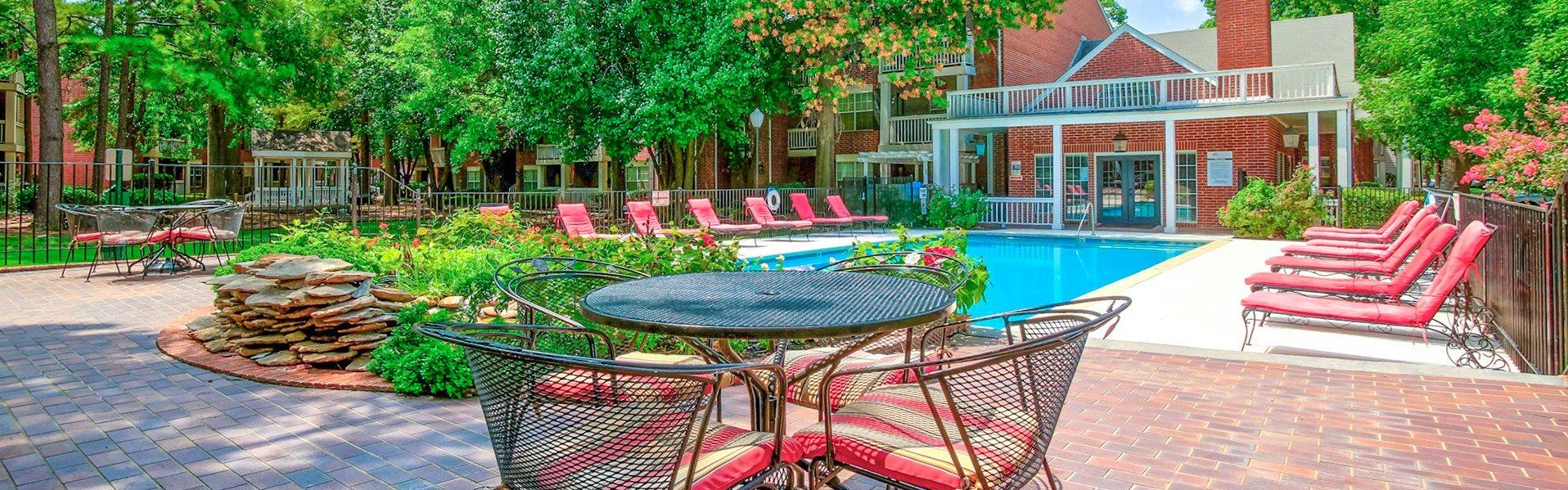 Greenbriar Apartments in Tulsa Oklahoma has a sparkling pool with lounge chairs surrounding it. Now renting 1 and 2 bedrooms!