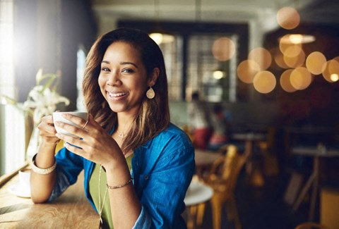 woman enjoying coffee in a cafe at Bridgeport Suffok, near 3800 Acqua
