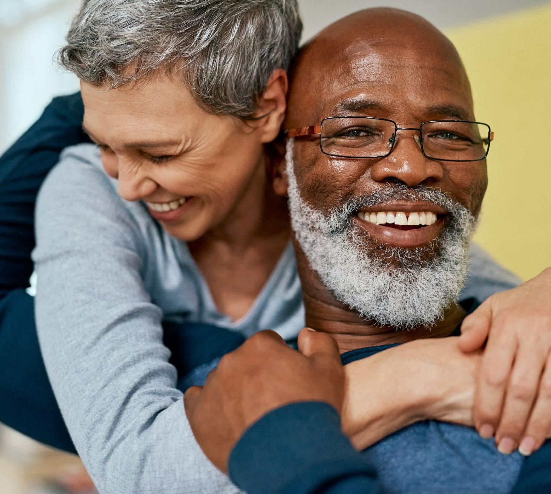 Elderly Male and Female Hugging