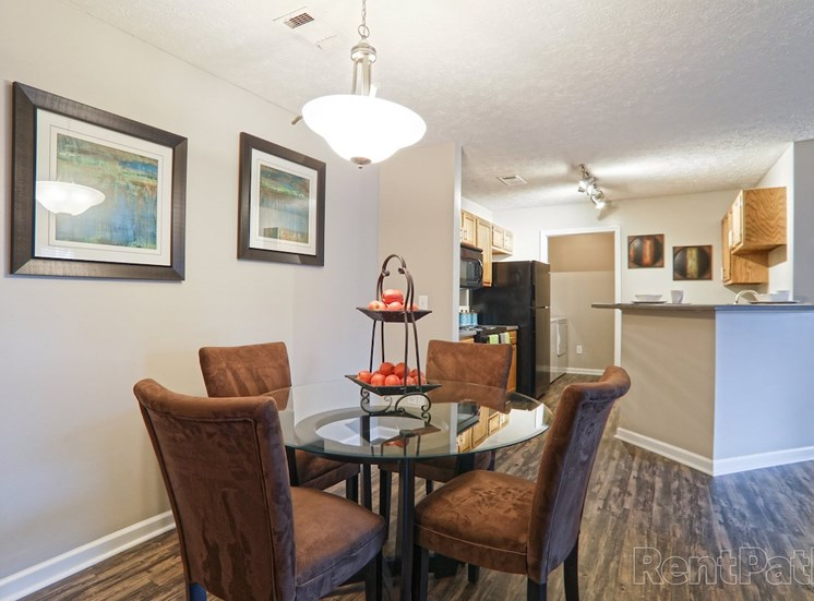 separate dining area with pendant lighting and hardwood-style flooring at The Point at Fairview Apartments, Prattville, 36066