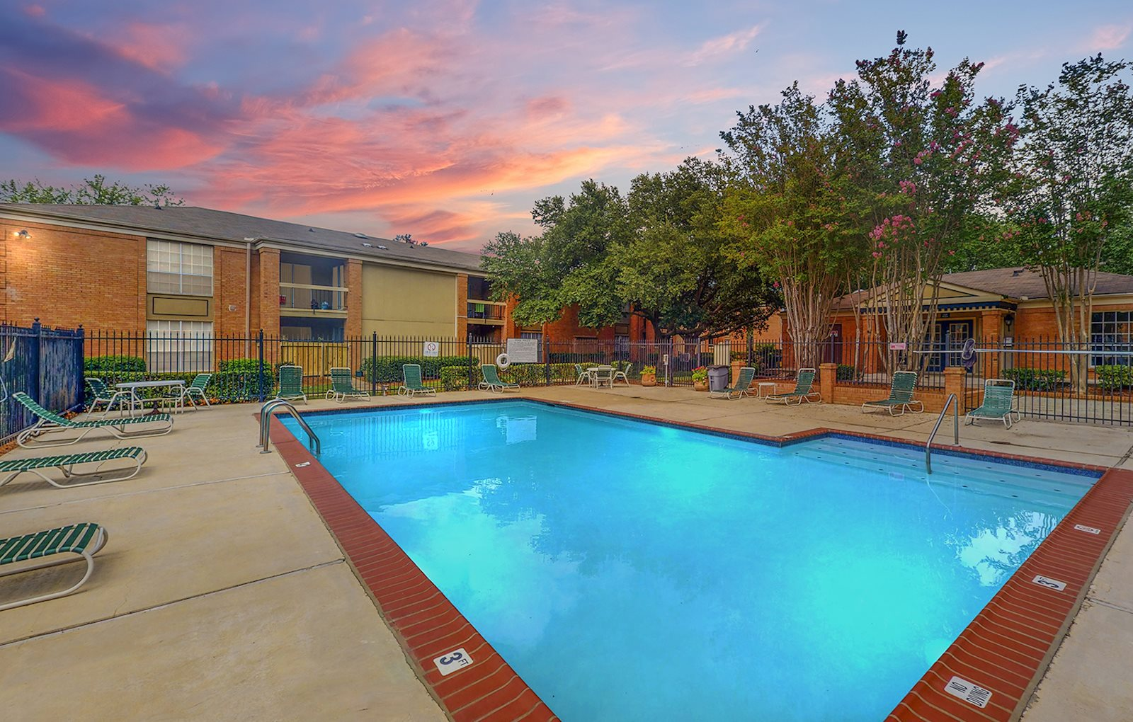 Swimming pool and large sundeck at sunset at Hampton House Apartments, Jackson, 39211