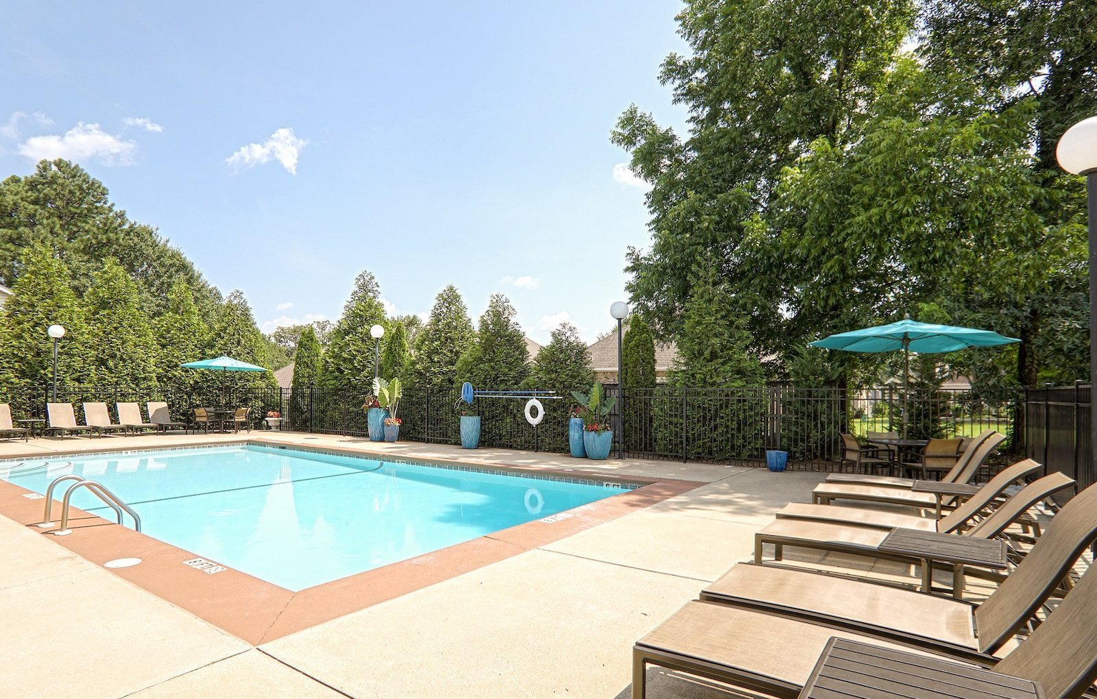 Swimming pool with sundeck and lounge furniture at The Point at Fairview Apartments, Prattville, Alabama