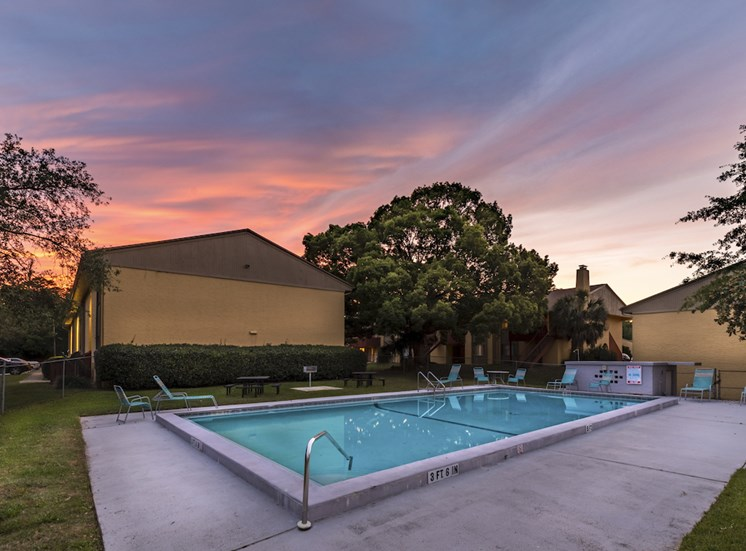 sunset over buildings and swimming pool at Reserve at Midtown Apartments, Tallahassee