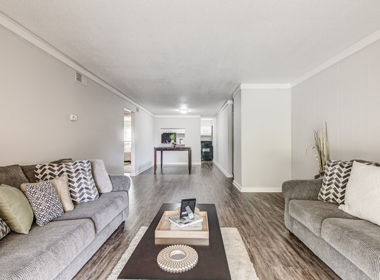 large living and dining area with window into kitchen at Reserve at Midtown Apartments, Tallahassee, 32303
