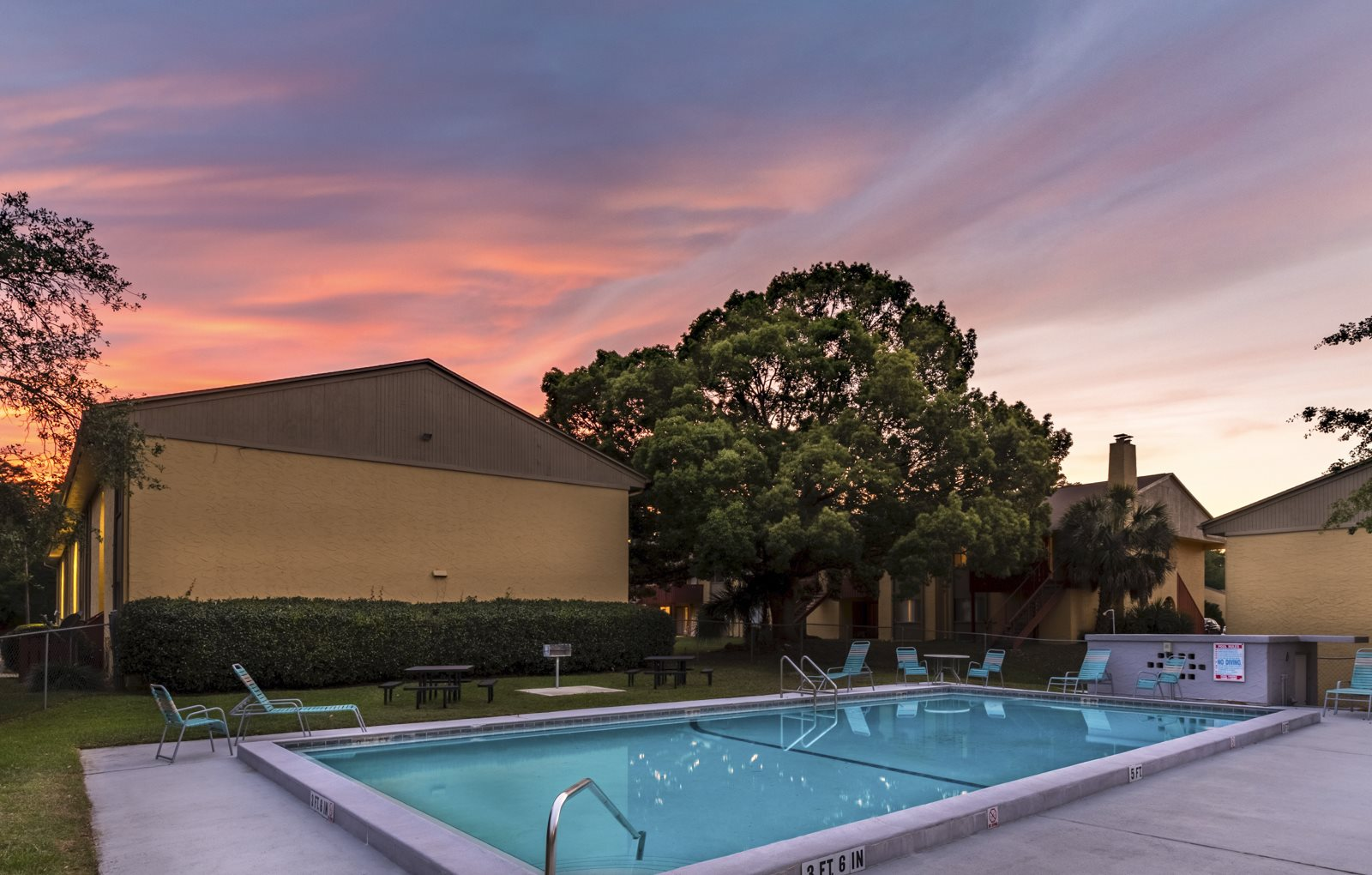 Sunset over swimming pool at Reserve at Midtown Apartments, Tallahassee, 32303
