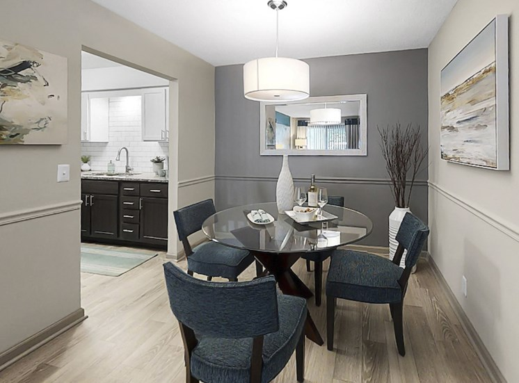 dining area with pendant lighting, plank-style flooring, and model dining set