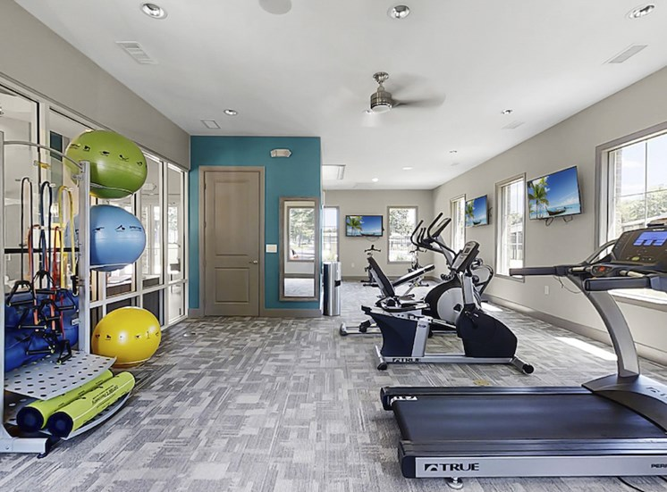 fitness center with cardio, strength, and yoga equipment