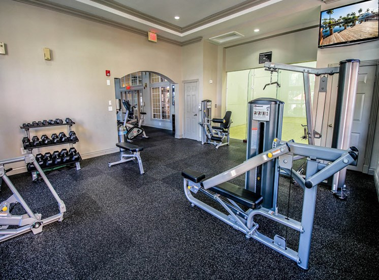 24-Hour Fitness Center free weights and tvs