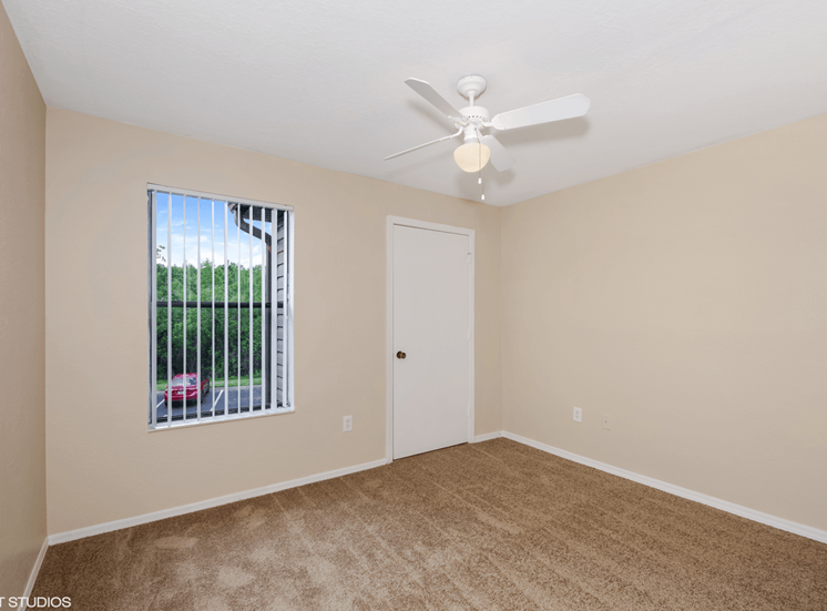 Bedroom with carpet flooring and multi speed ceiling fan