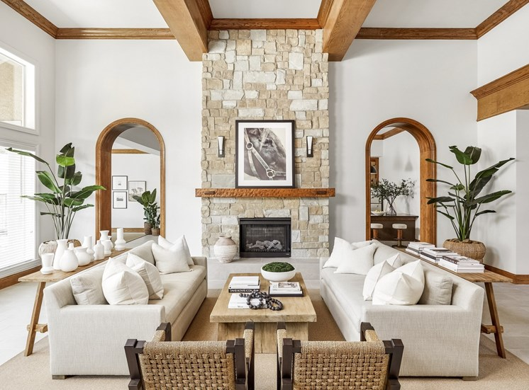 Clubhouse lounge area with arm chairs and coffee table with Fireplace