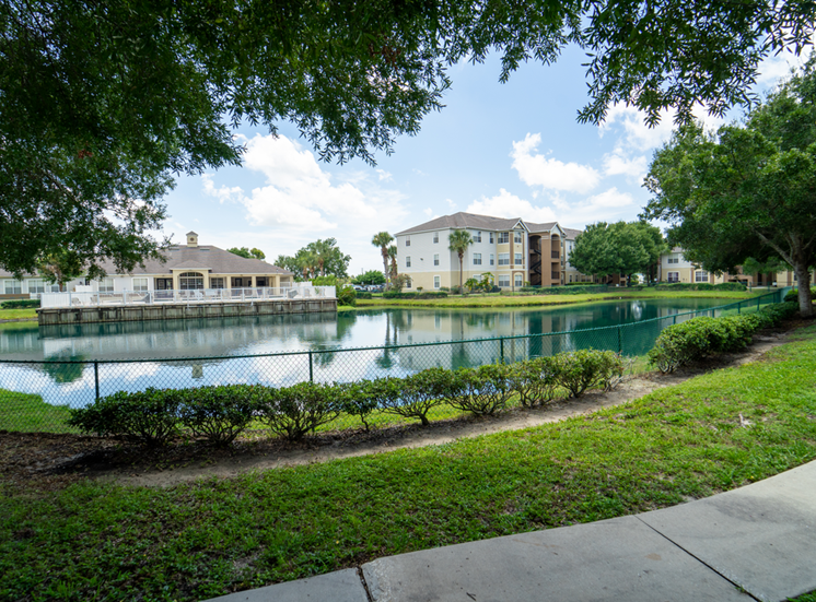 Apartment building exterior with lake views and walking paths