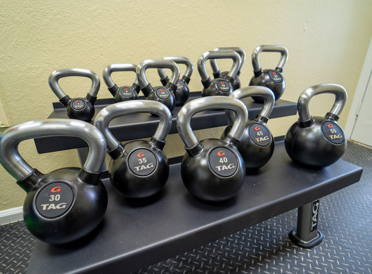 Fitness center equipped with kettlebells
