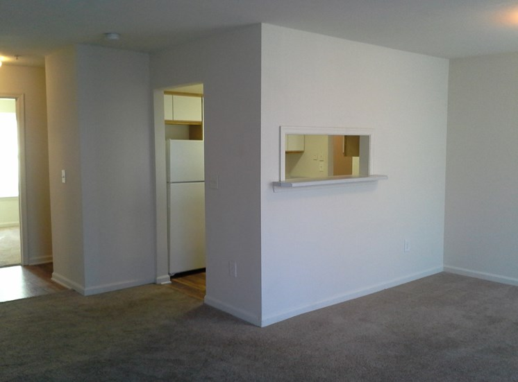 Carpeted Living Room Connected to Breakfast Bar of Kitchen