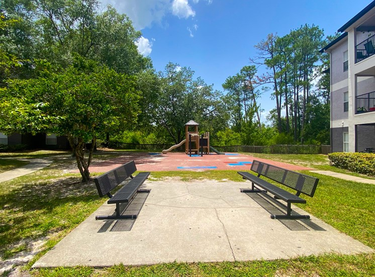 Outdoor benches next to playground