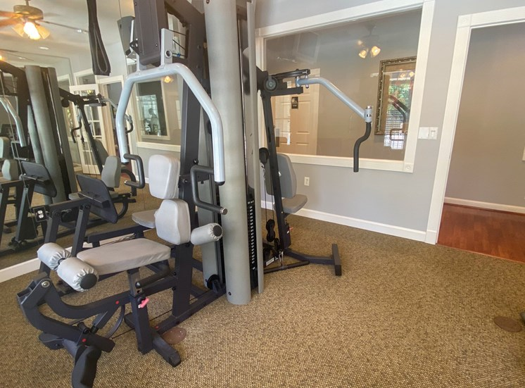 Carpeted Fitness Center with strength machines.