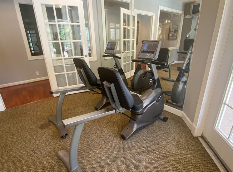 Fitness Center with two stationary bikes in front of a mirror