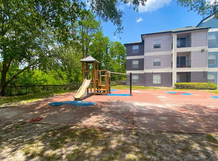 Outdoor playground with slide, latter, and monkey bars
