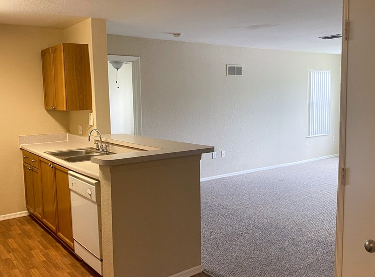 Kitchen with hardwood style flooring, double basin sink, and breakfast bar