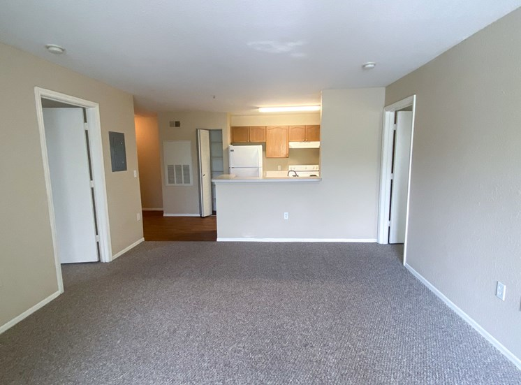 Living room with carpet flooring and kitchen breakfast bar