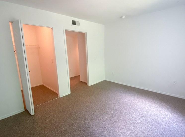 Carpeted Bedroom with folding closet door