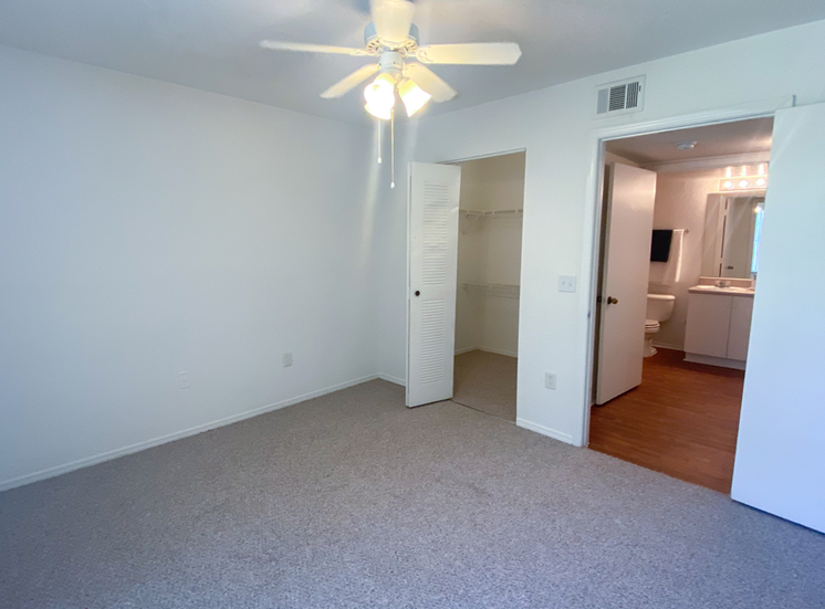 Spacious Bedroom with walk-in closet, in-suite bathroom, and multi speed ceiling fan