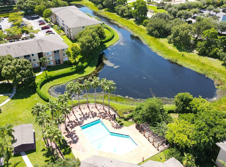 Aerial View of Apartment Community with Body of Water