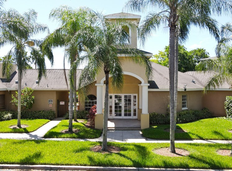 Leasing Office Exterior with Walkway and Palm Trees