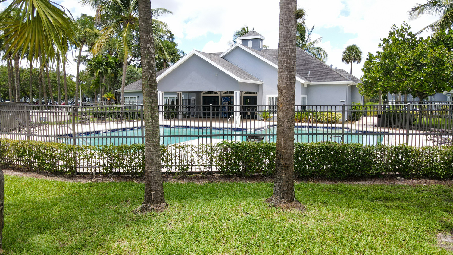 Fenced in Swimming Pool with Sundeck Next to Leasing Office