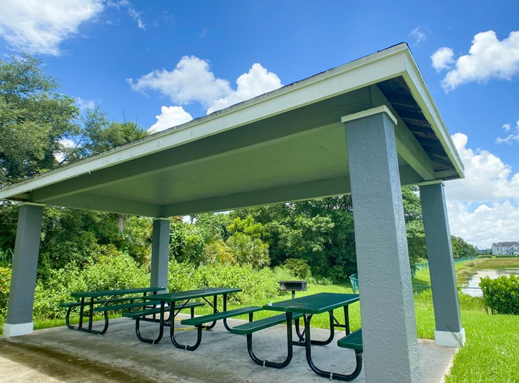 Covered Picnic Area Next to Treeline in Courtyard