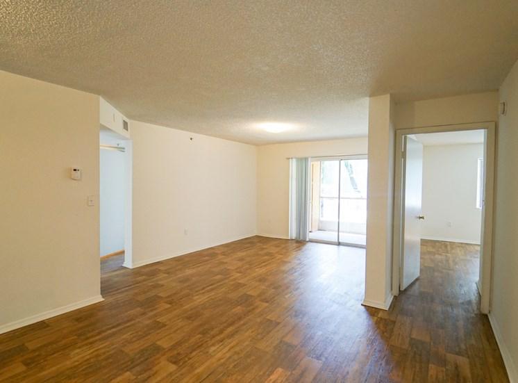 Open Floor Plan with Hardwood Style Flooring and Sliding Glass  Patio Door