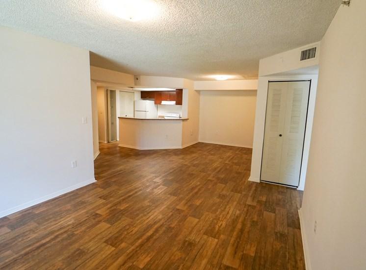 Open Floor Plan with Hardwood Style Flooring and Breakfast Bar off of Kitchen